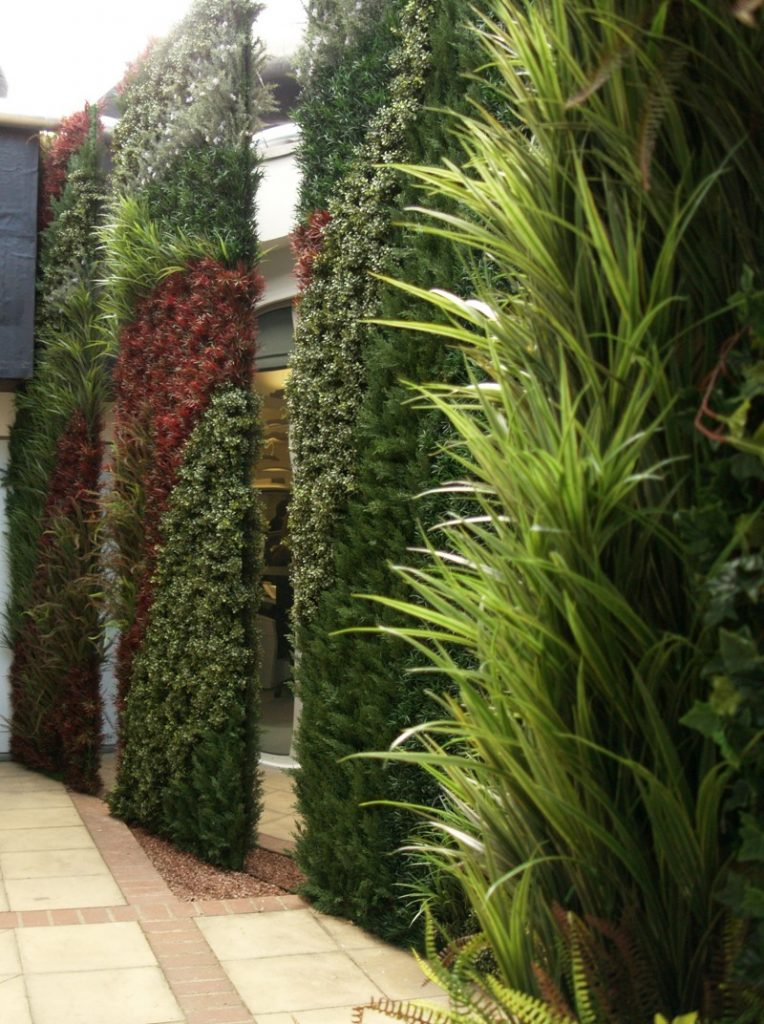 4 metre tall exterior grade wall with stainless steel panels
