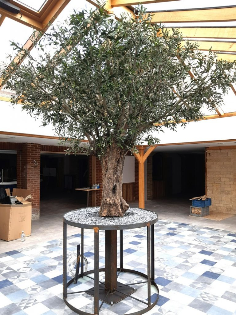 Artificial Olive tree with a real olive trunk on bespoke metal frame