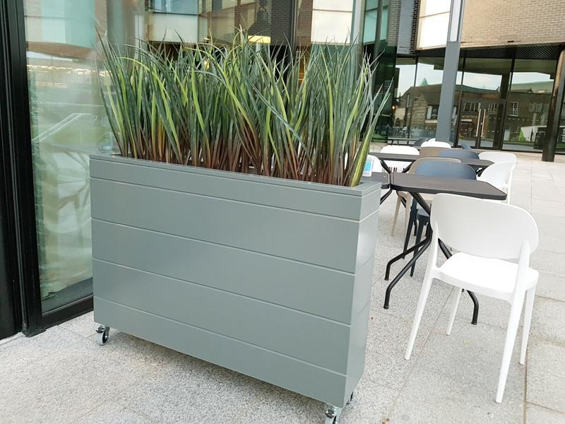 Artificial grass trough screening exterior