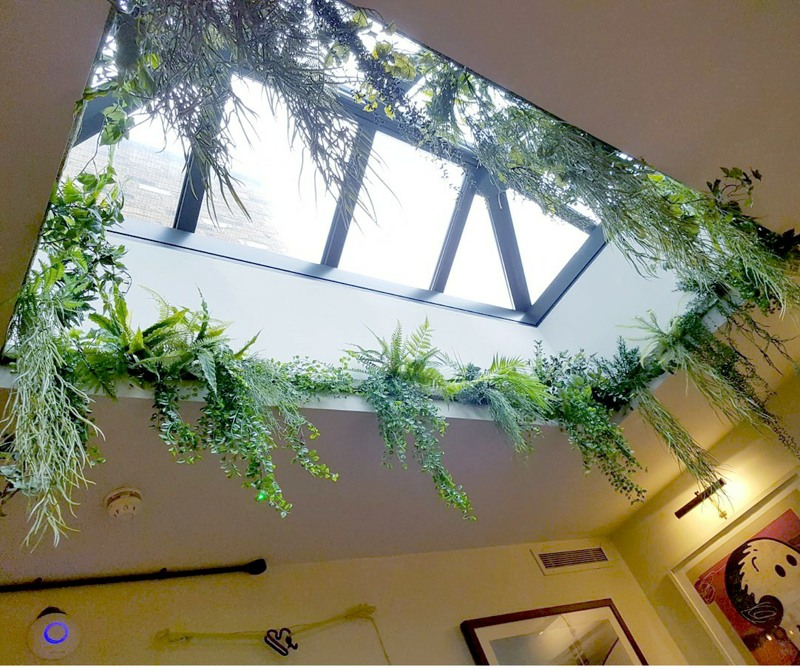 Artificial mixed foliage surrounding roof lantern