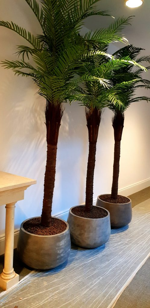 Artificial palms trees in pots