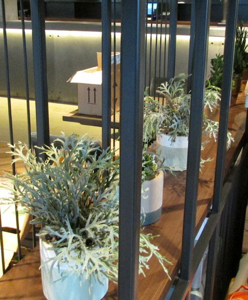 Artificial plants in pots for shelving