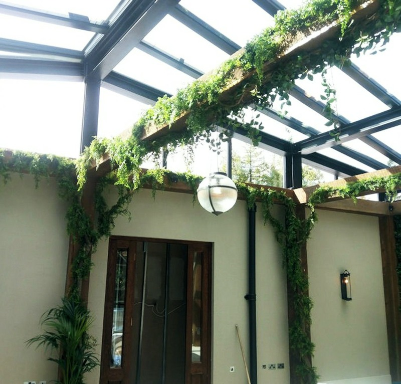 Artificial vines foliated and applied to interior beams in a hotel