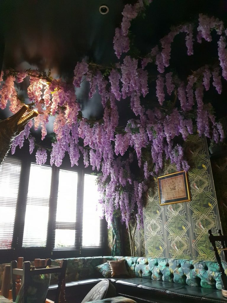 Artificial wisteria suspended from the ceiling