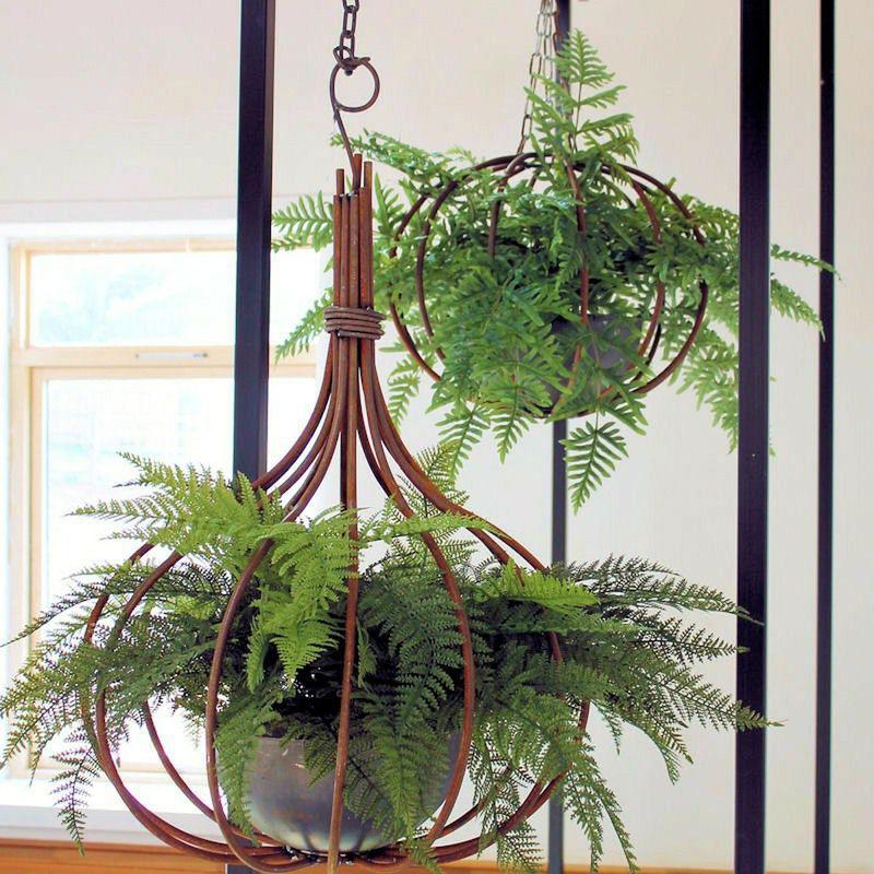 Bespoke artificial ferns in onion shaped basket
