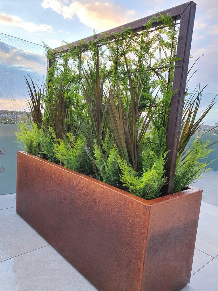 Corten steel trough with artificial planting exterior