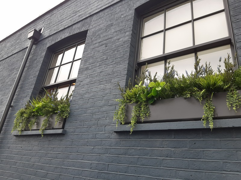 Exterior troughs with artificial trailing foliage
