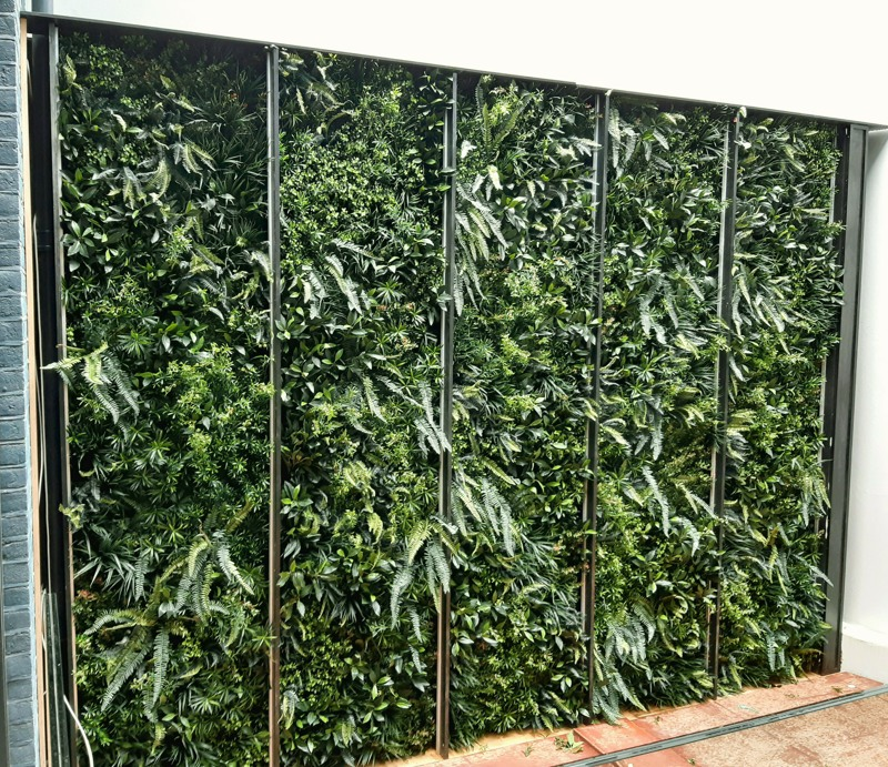 Fake green plant wall in panels by Bright Green