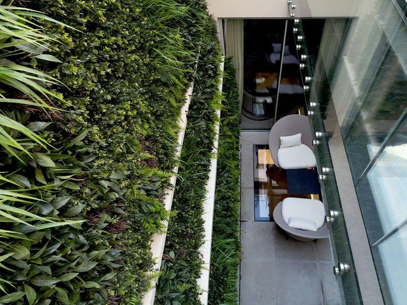 Faux green wall in lightwell