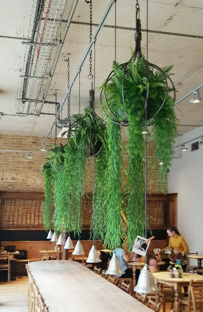Hanging bespoke hanging onion shape baskets filled with artificial ferns