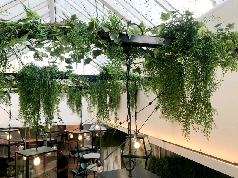 High Level artificial planting on interior steel beams