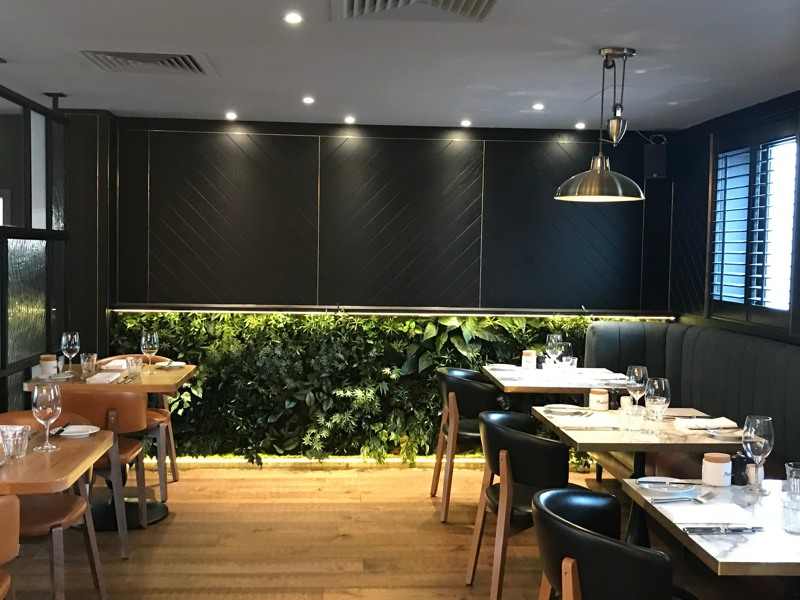 Low level artificial green wall restaurant