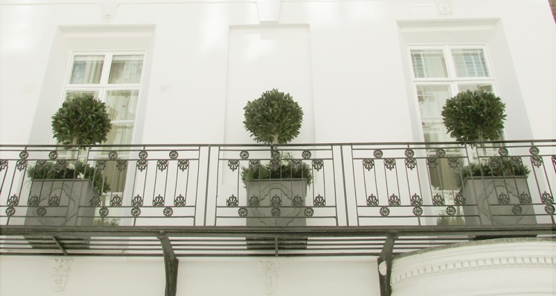 Set of artificial bay trees on balcony