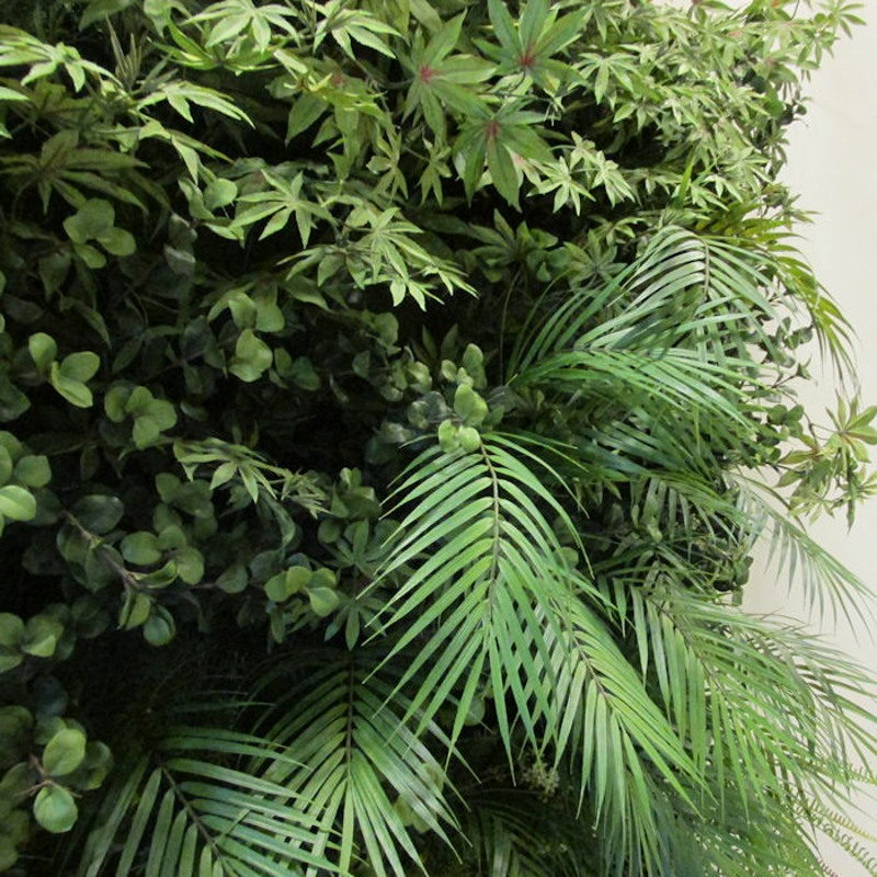 artificial palms on fake living wall