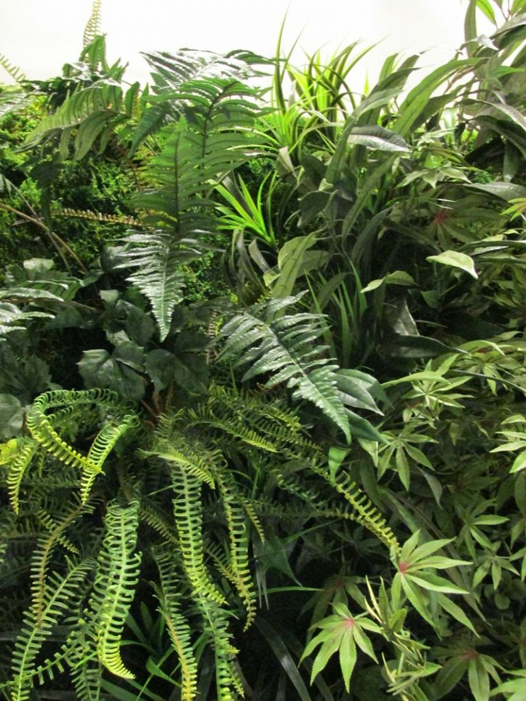 close up of faux foliages for green wall by Bright Green
