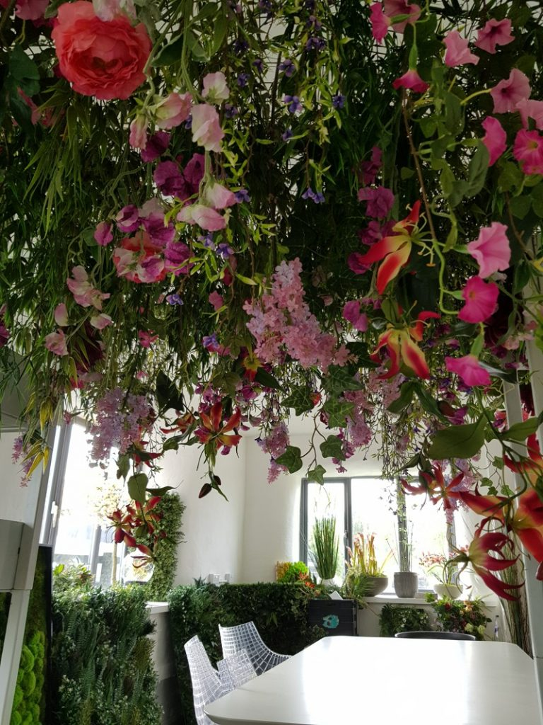 fake hanging raft planting with colourful flowers