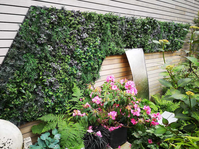 Artificial outdoor green wall with water feature Gallery